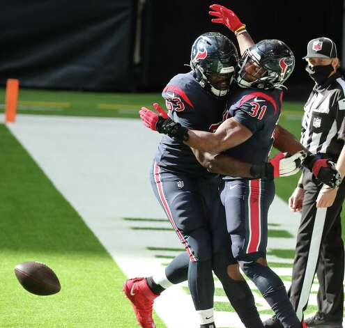 Houston Texans running back David Johnson (31) and offensive tackle Roderick Johnson (63) celebrate Johnson's 3-yard touchdown run against the Cincinnati Bengals during the third quarter of an NFL football game at NRG Stadium on Sunday, Dec. 27, 2020, in Houston. Photo: Brett Coomer, Staff Photographer / © 2020 Houston Chronicle