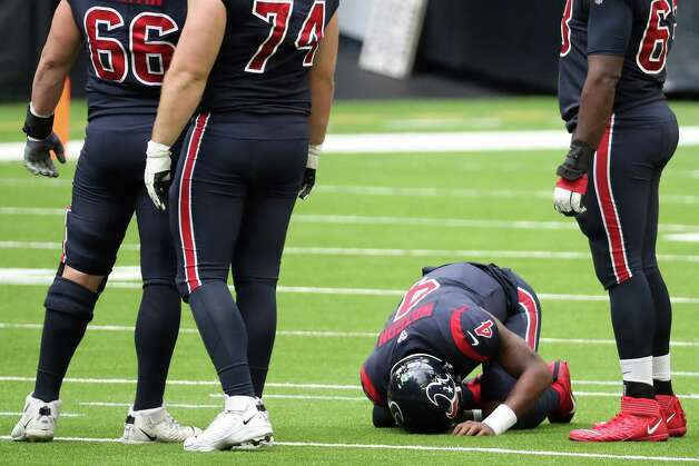 Houston Texans quarterback Deshaun Watson (4) lies on the field after he was sacked by the Cincinnati Bengals during the fourth quarter of an NFL football game at NRG Stadium on Sunday, Dec. 27, 2020, in Houston. Photo: Brett Coomer, Staff Photographer / © 2020 Houston Chronicle