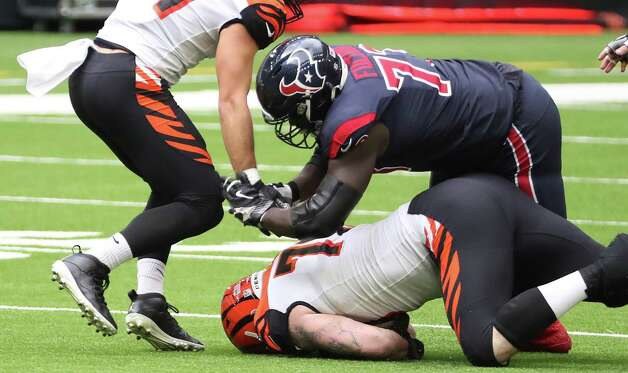 Cincinnati Bengals defensive end Margus Hunt (70) dives under Houston Texans offensive guard Zach Fulton (73) to recover a Deshaun Watson fumble during the fourth quarter of an NFL football game at NRG Stadium on Sunday, Dec. 27, 2020, in Houston. Photo: Brett Coomer, Staff Photographer / © 2020 Houston Chronicle
