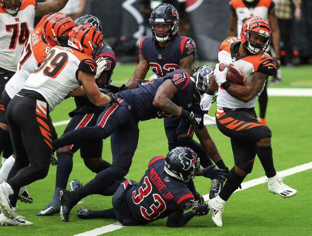 Cincinnati Bengals running back Samaje Perine (34) breaks away from Houston Texans safety A.J. Moore (33) and inside linebacker Zach Cunningham (41) to score on a 3-yard touchdown run during the fourth quarter of an NFL football game at NRG Stadium on Sunday, Dec. 27, 2020, in Houston. Photo: Brett Coomer, Staff Photographer / © 2020 Houston Chronicle