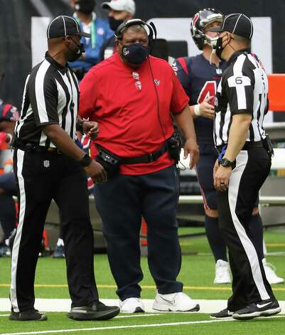 Houston Texans head coach Romeo Crennel talks to head linesman Jerod Phillips (6) during a tie out in the fourth quarter of an NFL football game against the Cincinnati Bengals at NRG Stadium on Sunday, Dec. 27, 2020, in Houston. Photo: Brett Coomer, Staff Photographer / © 2020 Houston Chronicle