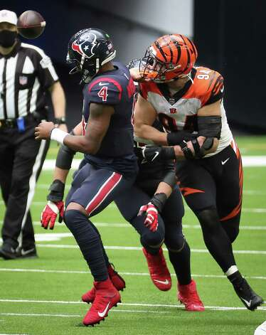 Houston Texans quarterback Deshaun Watson (4) fumbles as he is sacked by Cincinnati Bengals defensive end Sam Hubbard (94) during the fourth quarter of an NFL football game at NRG Stadium on Sunday, Dec. 27, 2020, in Houston. The Bengals recovered the fumble for a turnover. Photo: Brett Coomer, Staff Photographer / © 2020 Houston Chronicle