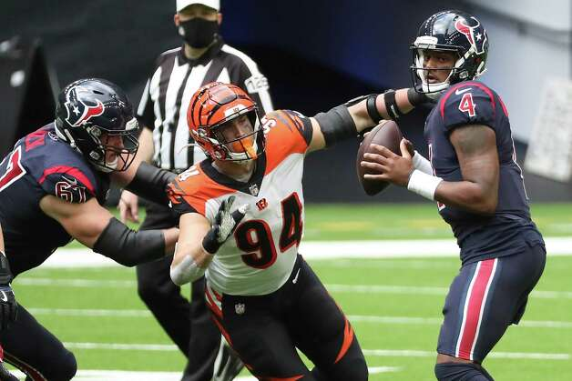 Cincinnati Bengals defensive end Sam Hubbard (94) beats Houston Texans offensive tackle Charlie Heck (67) for a sack of quarterback Deshaun Watson (4) during the fourth quarter of an NFL football game at NRG Stadium on Sunday, Dec. 27, 2020, in Houston. Watson fumbled on the play and the Bengals recovered for a turnover. Photo: Brett Coomer, Staff Photographer / © 2020 Houston Chronicle