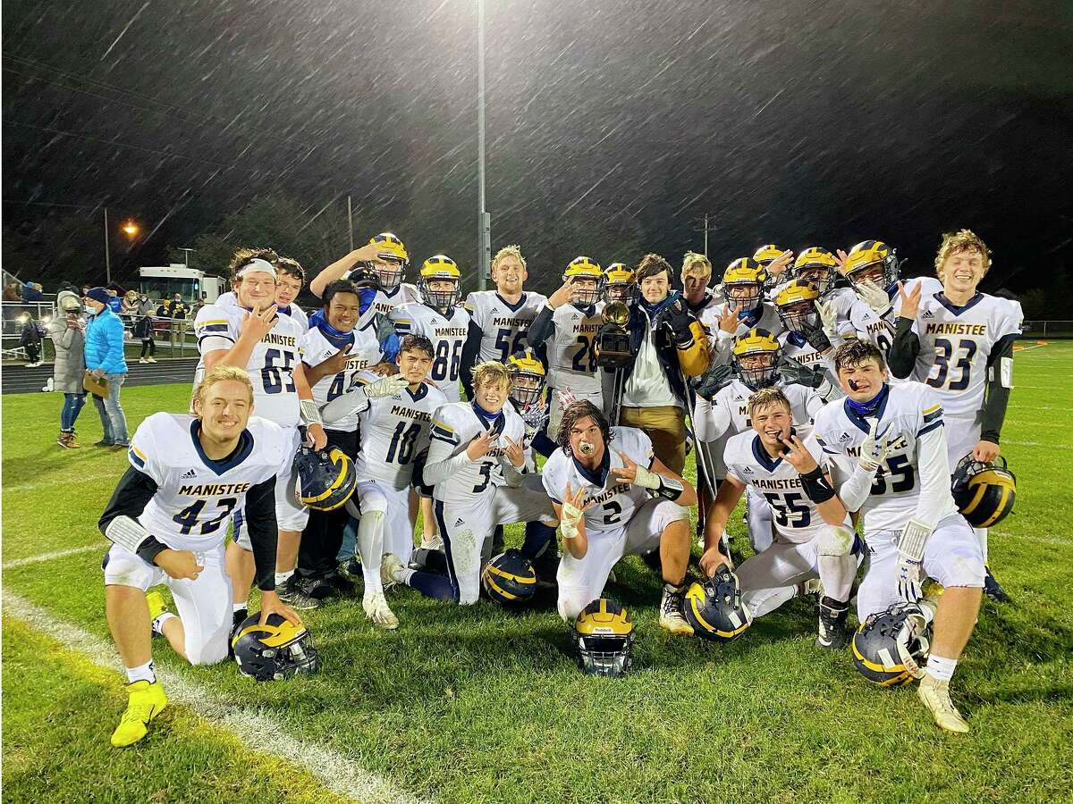 The Manistee Chippewas celebrate a rivalry victory over Ludington this season. Nick Weaver (back row, No. 56) was named second team All-State as a lineman in Division 5-6 football. (News Advocate file photo)