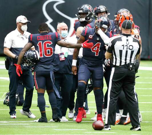 Cincinnati Bengals wide receiver Tee Higgins (85) and Houston Texans wide receiver Keke Coutee (16) try to comfort quarterback Deshaun Watson (4) after he was sacked, fumbled the ball and the Cincinnati Bengals recovered it for the turnover in the last two minutes during the fourth quarter of an NFL football game at NRG Stadium, Sunday, December 27, 2020, in Houston. Photo: Karen Warren, Staff Photographer / © 2020 Houston Chronicle