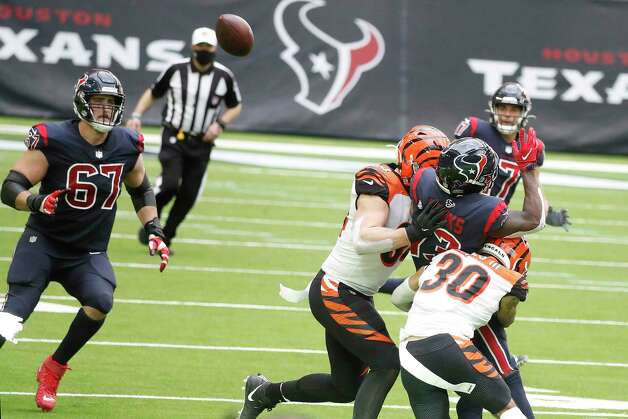 Houston Texans wide receiver Brandin Cooks (13) passes the ball back during a multiple lateral last play for the Texans in the fourth quarter of an NFL football game at NRG Stadium, Sunday, December 27, 2020, in Houston. Photo: Karen Warren, Staff Photographer / © 2020 Houston Chronicle