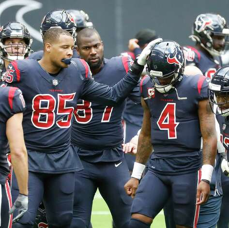 Houston Texans quarterback Deshaun Watson (4) is comforted by Pharaoh Brown (85) as they walked back to the bench after Watson was sacked, fumbled the ball and the Cincinnati Bengals recovered it for the turnover in the last two minutes during the fourth quarter of an NFL football game at NRG Stadium, Sunday, December 27, 2020, in Houston. Photo: Karen Warren, Staff Photographer / © 2020 Houston Chronicle