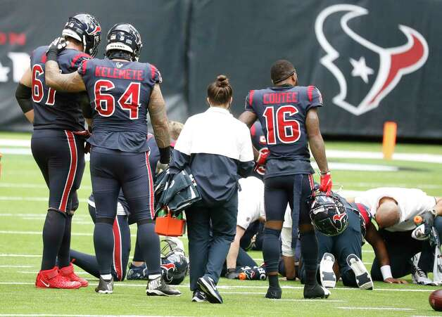 Houston Texans offensive tackle Charlie Heck (67) and offensive guard Senio Kelemete (64) hug next to an injured Deshaun Watson who crumpled to the ground after he was sacked, fumbled the ball and the Cincinnati Bengals recovered it for the turnover in the last two minutes of the fourth quarter of an NFL football game at NRG Stadium, Sunday, December 27, 2020, in Houston. Photo: Karen Warren, Staff Photographer / © 2020 Houston Chronicle