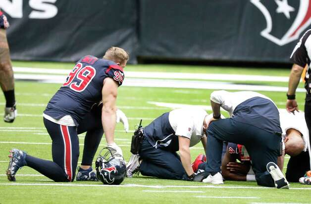 Houston Texans defensive end J.J. Watt (99) kneels next to an injured Deshaun Watson who crumpled to the ground after he was sacked, fumbled the ball and the Cincinnati Bengals recovered it for the turnover in the last two minutes of the fourth quarter of an NFL football game at NRG Stadium, Sunday, December 27, 2020, in Houston. Photo: Karen Warren, Staff Photographer / © 2020 Houston Chronicle