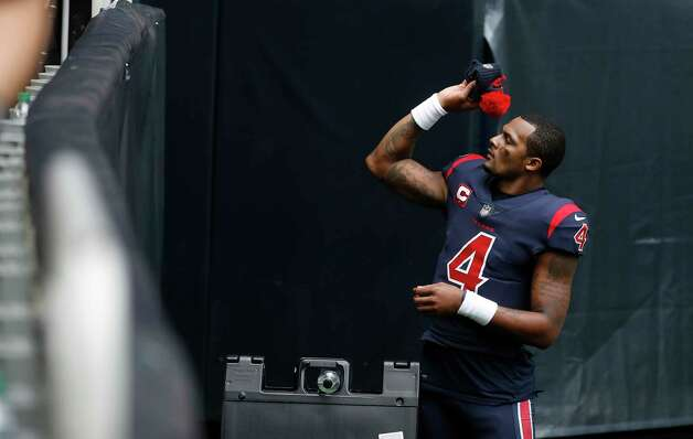 Houston Texans quarterback Deshaun Watson (4) tosses his hat to a fan as he walked back to the locker room after the Texans 37-31 loss to the Cincinnati Bengals after an NFL football game at NRG Stadium, Sunday, December 27, 2020, in Houston. Photo: Karen Warren, Staff Photographer / © 2020 Houston Chronicle