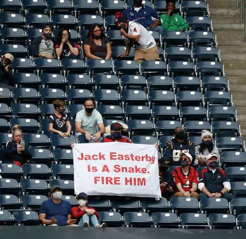 """A Houston Texans fan with a sign that reads """"Jack Easterby is a snake. Fire Him"""" in the stands during the fourth quarter of an NFL football game at NRG Stadium, Sunday, December 27, 2020, in Houston. Photo: Karen Warren, Staff Photographer / © 2020 Houston Chronicle"""