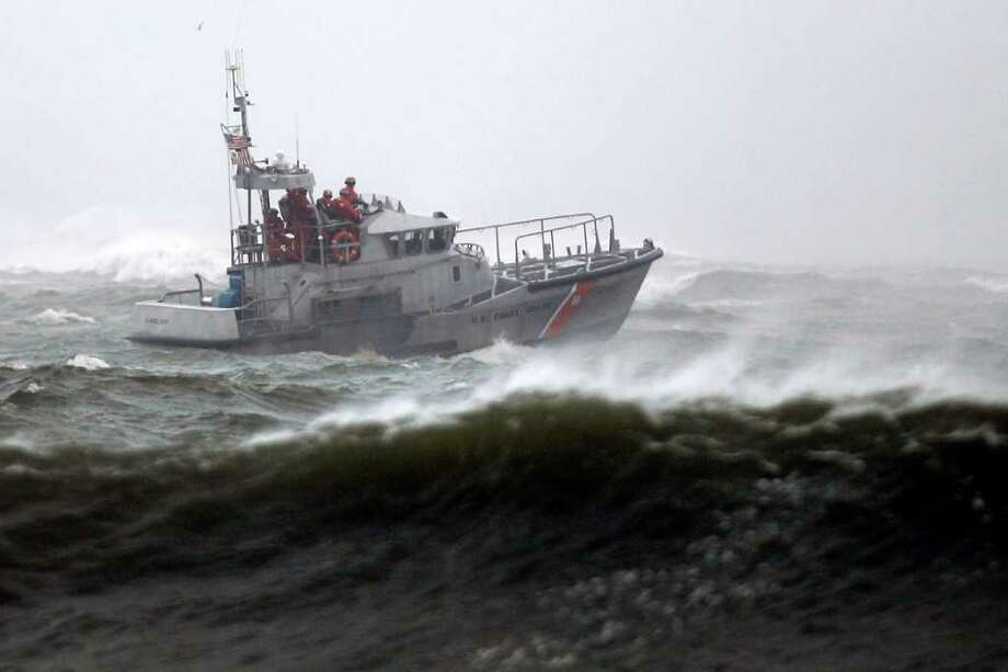 A Coast Guard vessel is seen off the coast of Atlantic City, N.J., as Hurricane Earl moves up the eastern coast, Friday, Sept. 3, 2010.  (AP Photo/Matt Rourke) Photo: Matt Rourke / AP
