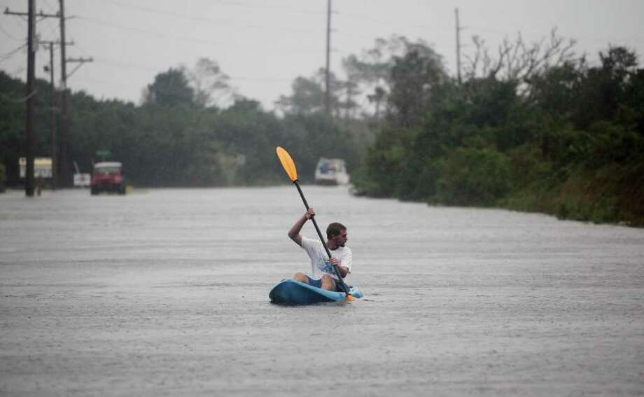 Scott Kerns kayaks down flooded Hwy 12 in Frisco, NC on Friday, Sept. 3, 2010.  Sound side flooding from Hurricane Earl flooded much of the Outer Banks in the early morning hours. ( AP Photo/The Virginian-Pilot, Steve Earley) Photo: Steve Earley