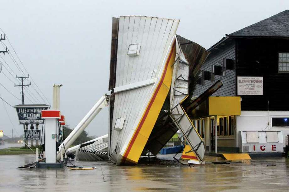 A metal roof is seen on the ground after winds from Hurricane Earl passed through overnight in Nags Head, N.C., Friday, Sept. 3, 2010. (AP Photo/Gerry Broome) Photo: Gerry Broome