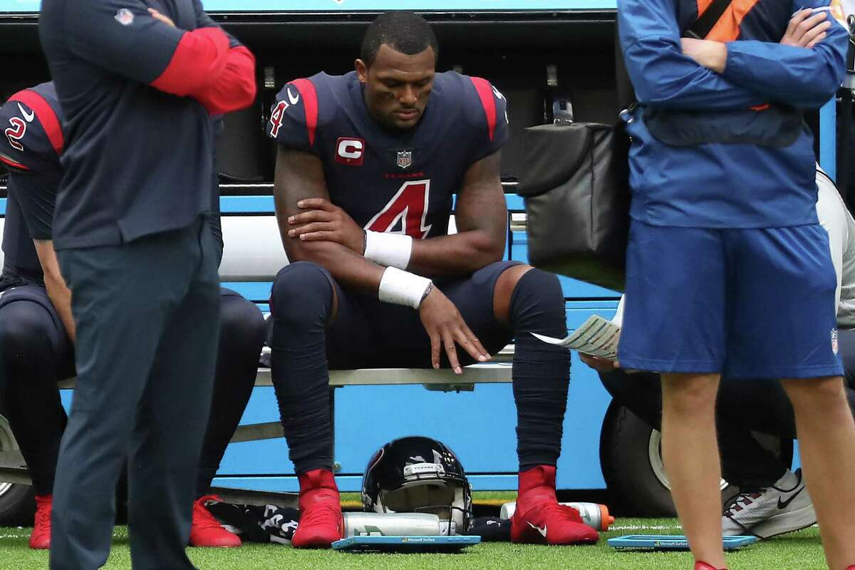 Houston Texans quarterback Deshaun Watson (4) sits on the bench holding his arm after suffering an injury after being sacked during the fourth quarter of an NFL football game against the Cincinnati Bengals at NRG Stadium on Sunday, Dec. 27, 2020, in Houston.