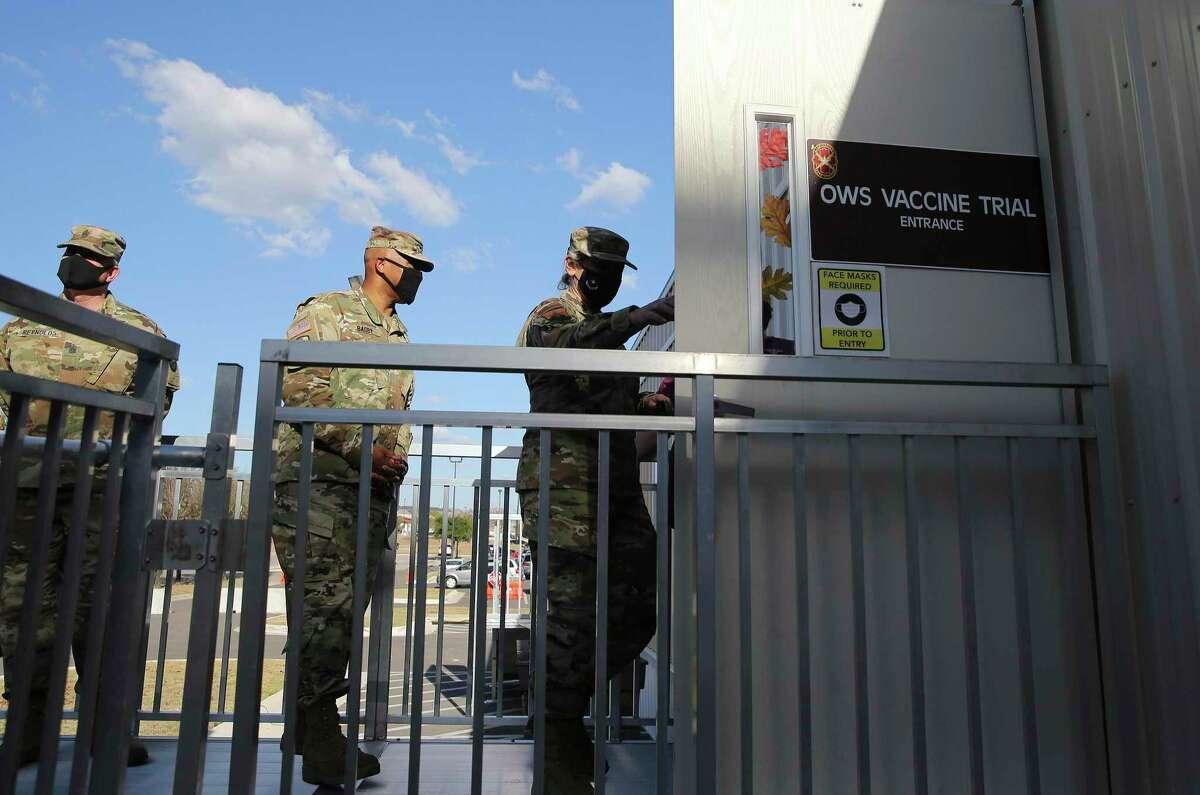 Brig. Gen. Shan Bagby, commander of Brooke Army Medical Center, takes part in a tour of Operation Warp Speed trial facilities there last month.