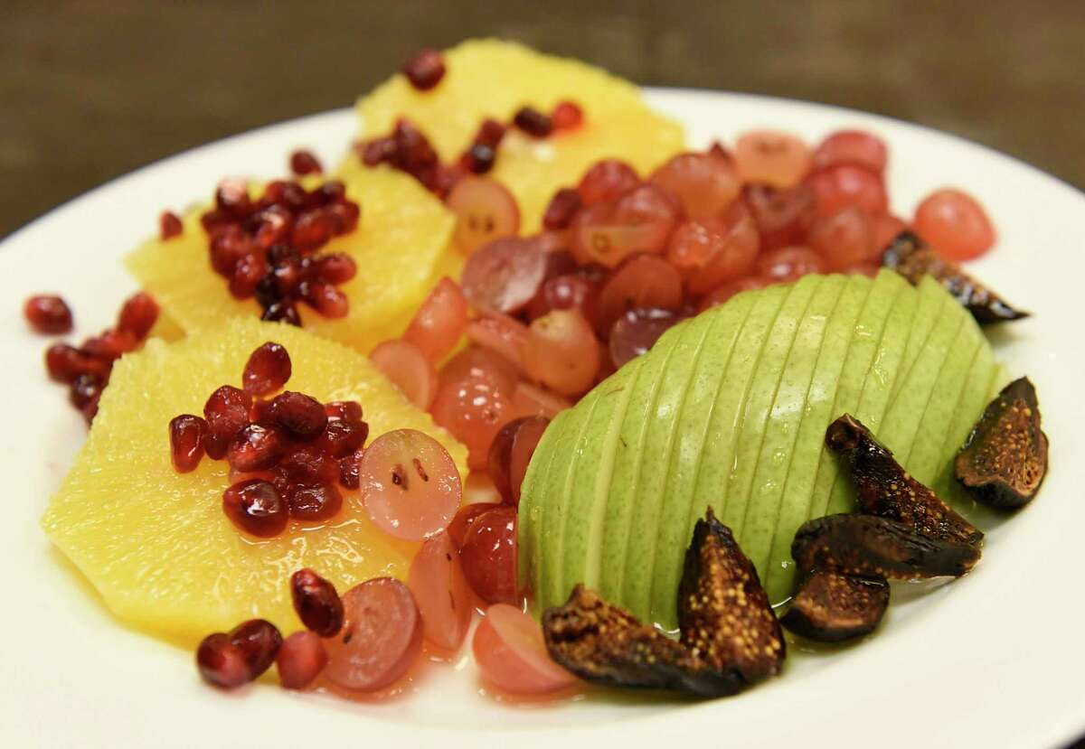 Winter fruit salad with citrus and honey drizzle Caroline Barrett prepared at Different Drummer's Kitchen in Stuyvesant Plaza on Wednesday, Dec. 23, 2020 in Albany, N.Y. (Lori Van Buren/Times Union)