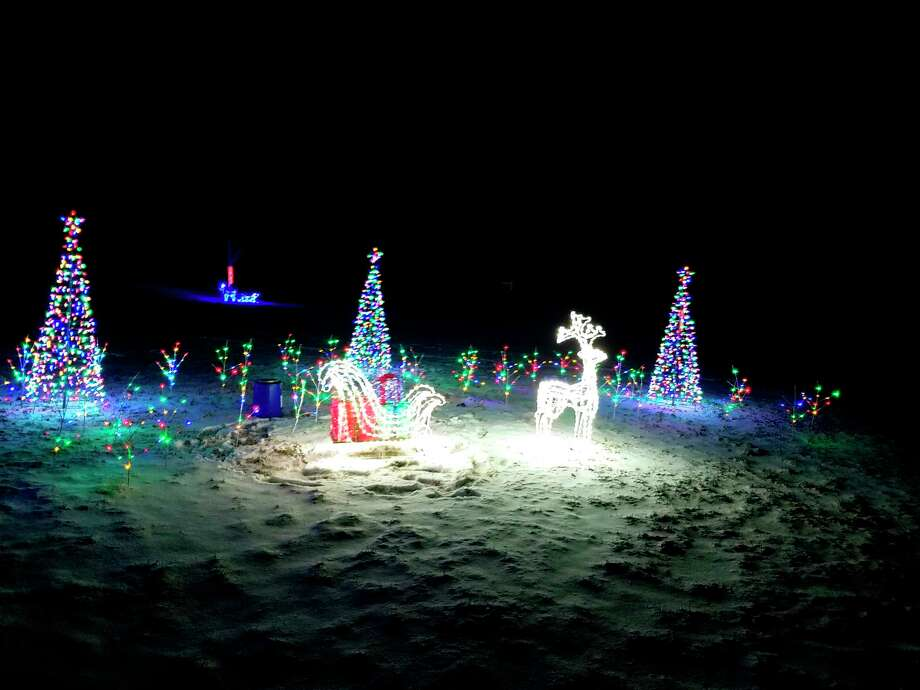 Lighted deer are part of the Stevens' family display.(Colin Merry/Record Patriot)