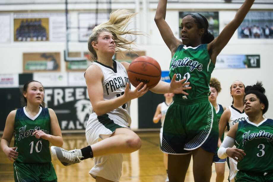 Freeland's Kadyn Blanchard takes it to the rim against Saginaw Heritage during the 2019-20 season. Photo: Daily News File Photo
