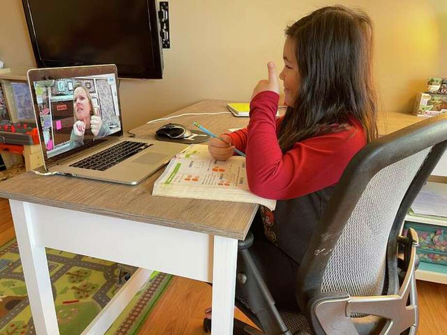Leclaire Elementary student Madelyn Ngo gives her teacher Jennifer Davin a thumbs up during a remote learning lesson. Photo: For The Intelligencer