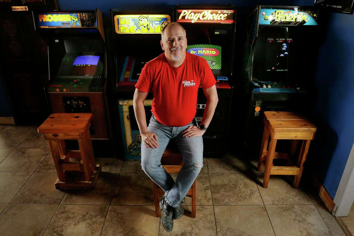 William Russell Keys, owner of The Game Preserve arcade, with some of the over 100 current, classic and vintage video and pinball games he has in the arcade Friday, Dec. 18, 2020 in Spring, TX. Key is having to make some hard decisions about the arcade in the face the financial consequences of the COVID-19 pandemic.