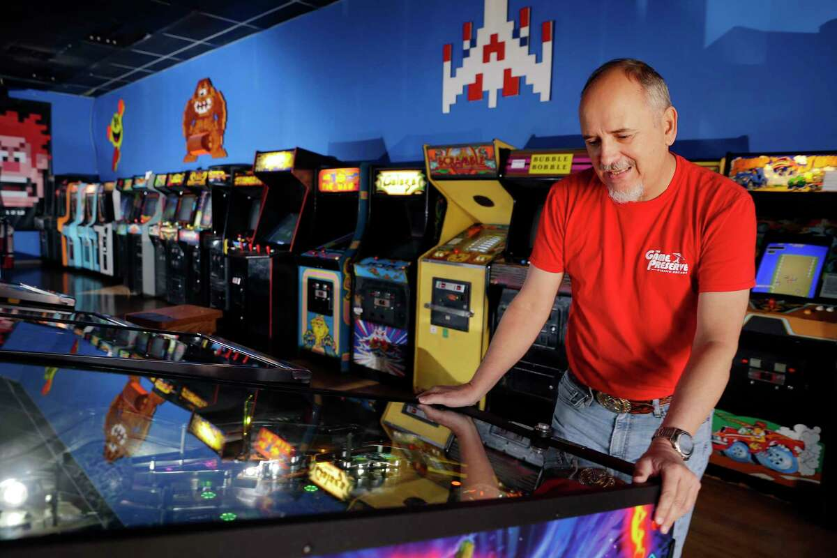 William Russell Keys, owner of The Game Preserve arcade, plays one of the over 100 current, classic and vintage video and pinball games he has in the arcade Friday, Dec. 18, 2020 in Spring, TX. Key is having to make some hard decisions about the arcade in the face the financial consequences of the COVID-19 pandemic.