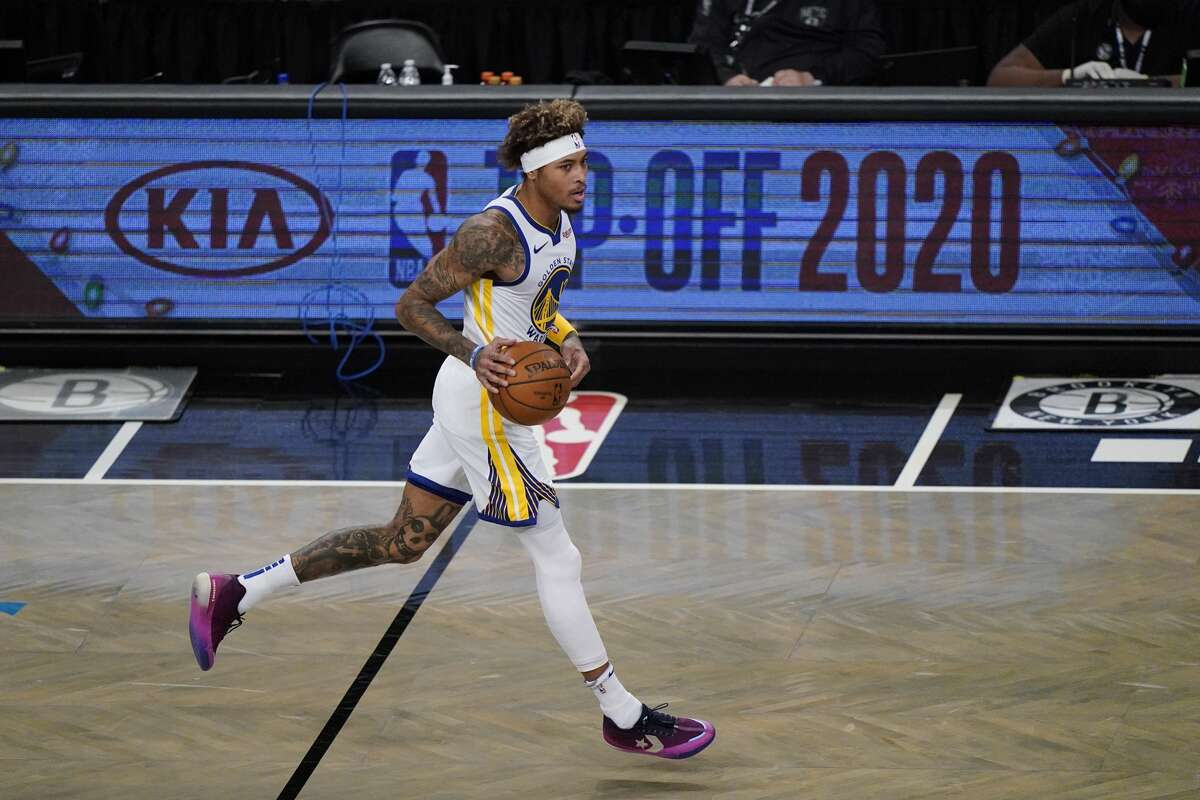 Golden State Warriors forward Kelly Oubre Jr. takes the ball down court during the first quarter of an opening night NBA basketball game, Tuesday, Dec. 22, 2020, in New York. (AP Photo/Kathy Willens)