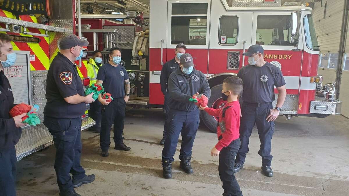 Danbury firefighters receive gifts from a local 8-year-old named Matthew on Christmas. The young resident has been bringing firefighters holiday gifts every year since he was 5.