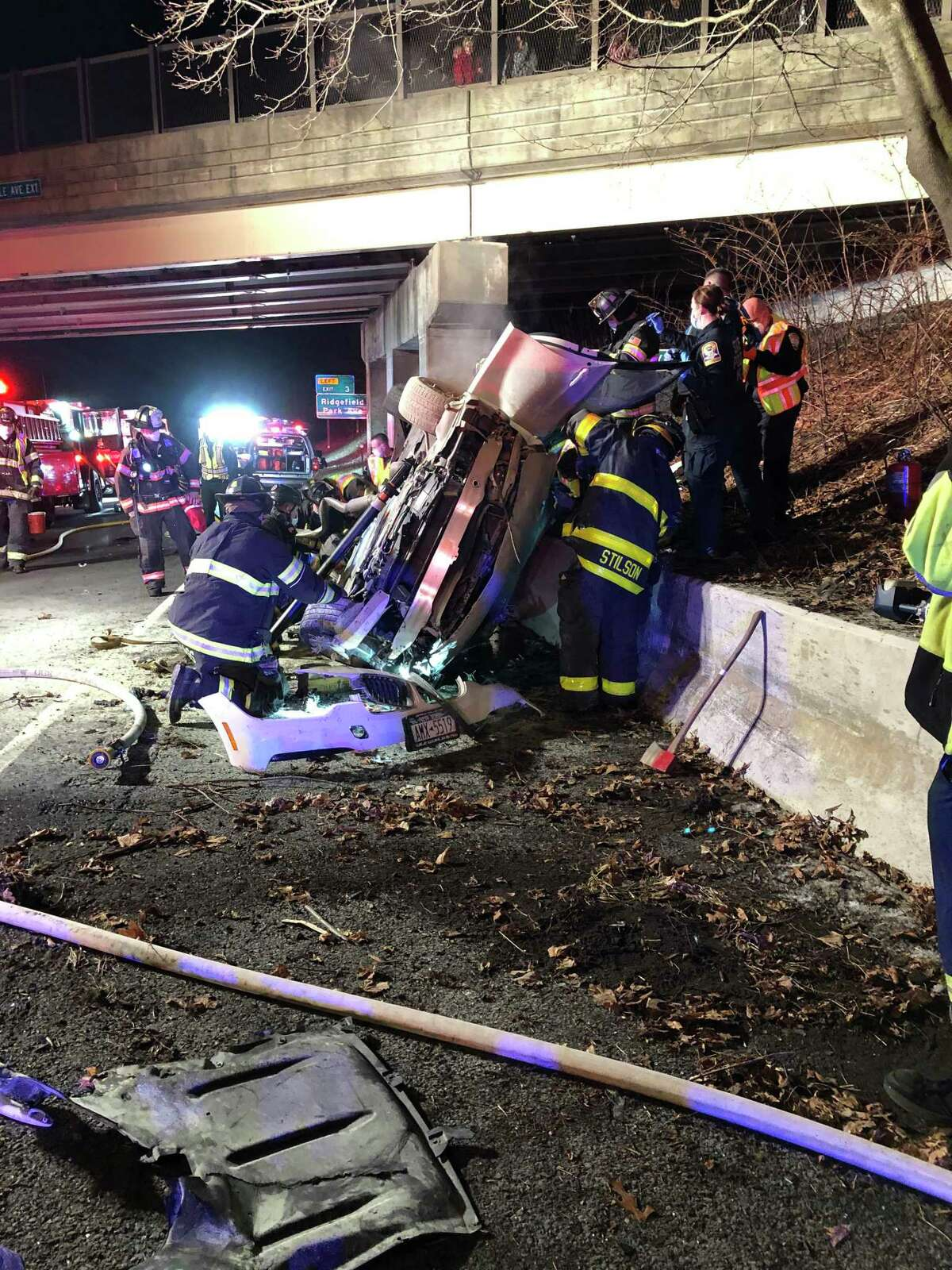 Danbury firefighters at the scene of a rollover crash on westbound I-84 Sunday night that sent four people to the hospital.