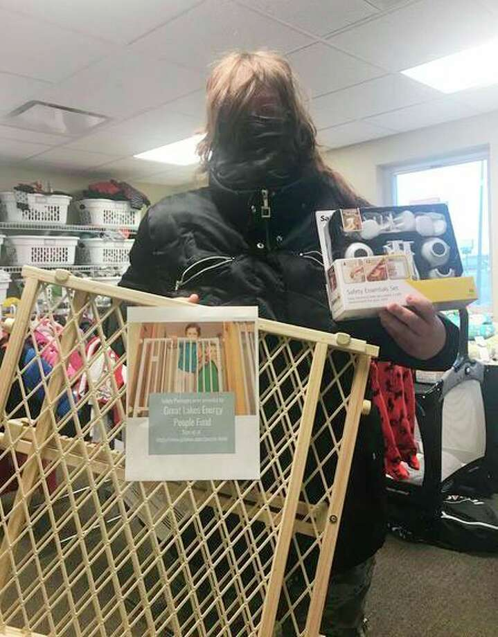 Pictured is Life Resources of Northern Michigan's first client to receive a safety package. The grant, from Great Lakes Energy, will provide baby-proofing items to 51 local families. (Courtesy photo)
