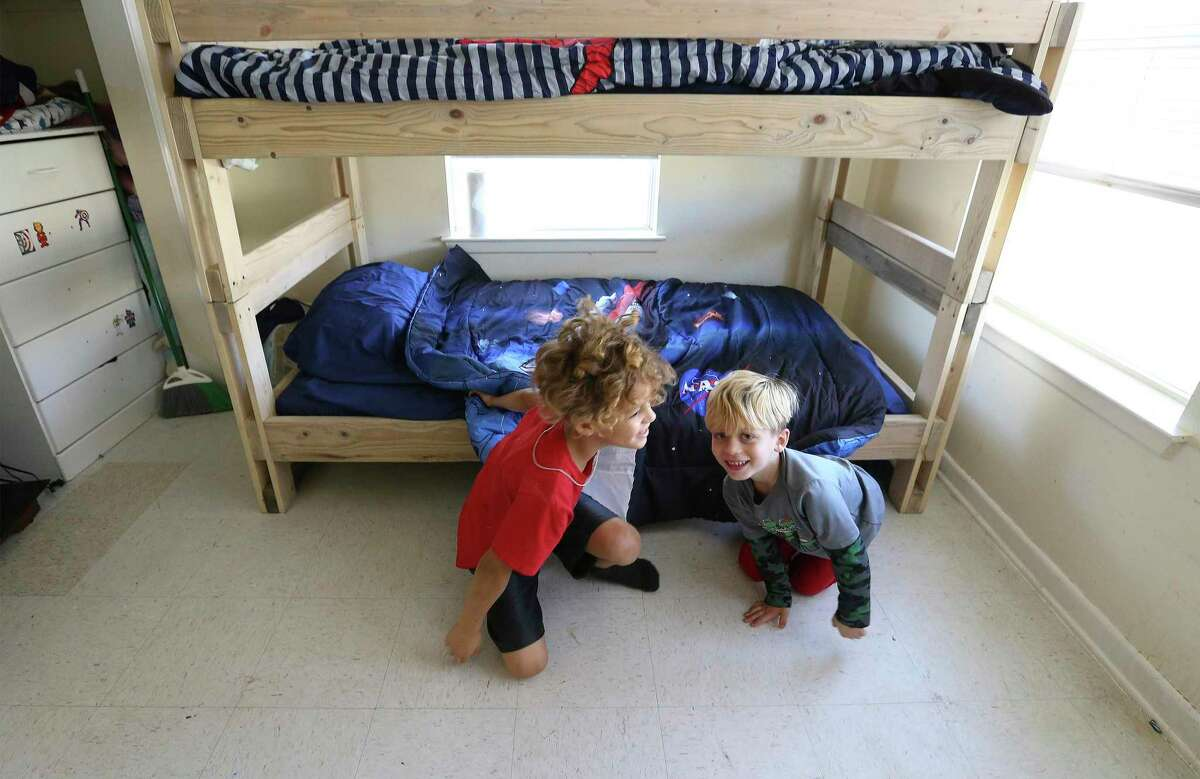 Brothers Jaylen and Elijah Cabot play beside their new bunk bed delivered by members of Sleep in Heavenly Peace on Thursday, Dec. 24, 2020. Since 2018, the nonprofit Sleep in Heavenly Peace has built and delivered beds to families who were in need of beds for children who mostly slept on air mattresses, couches or even on floors.