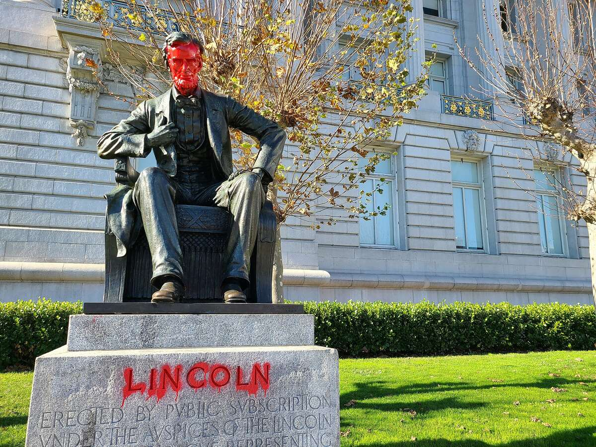 Red paint covers the face and name of Abraham Lincoln's statue at S.F. City Hall. The former president's legacy has sparked debate in S.F. and other cities.