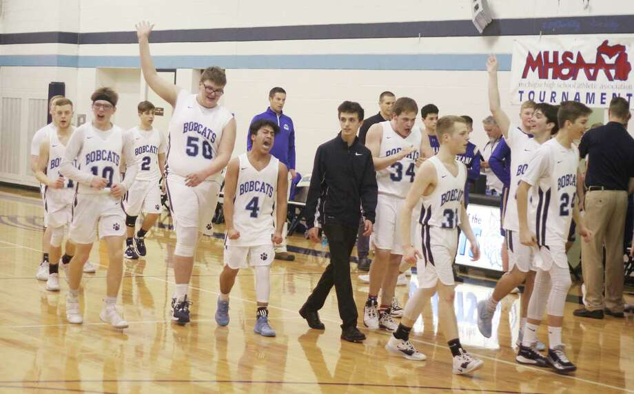 The Brethren boys basketball team celebrates its Division 4 district semifinal win over Onekama in March. The Bobcats' scheduled championship game against Frankfort was ultimately canceled due to the COVID-19 pandemic. (News Advocate file photo)
