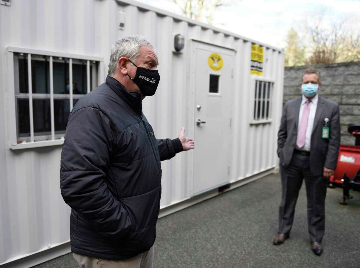 Larry Simon, chair of the board of directors at the Nathaniel Witherell, shows off a 'visitation pod' at the skilled nursing and rehabilitation center in Greenwich, Conn. Monday, Dec. 7, 2020. The pods offer a safe method for friends and family to visit their loved ones at the Nathaniel Witherell during the pandemic.