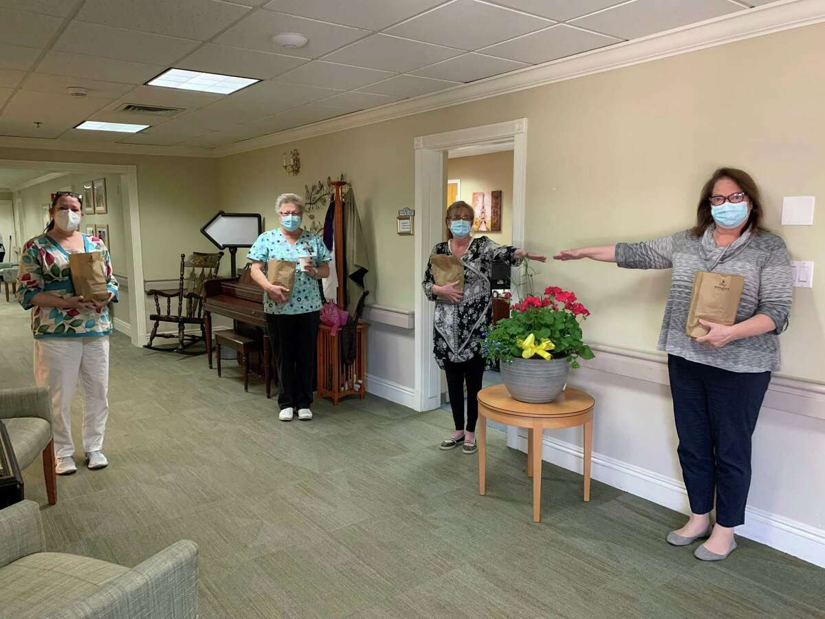 Staff and residents from Bishop Wicke Health and Rehabilitation Center in Shelton will receive the Covid-19 vaccination this week. Pictured, left to right, are staffers Beth Cairone, Evelyn Rupsis, Lori Bauer and Faith Wajdowicz.