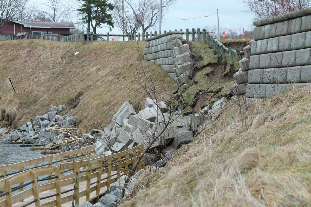 The retaining wall near a section of the Riverwalk along First Street in Manistee was damaged by erosion in 2020. It is scheduled to be repaired by spring or early summer. (File photo)