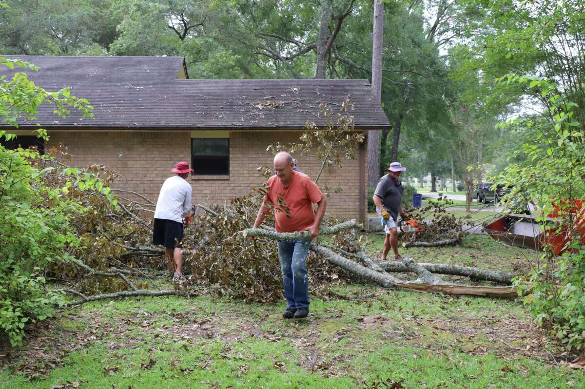 Father Ron Foshage is cleaning up debris caused by Hurricane Laura with the help of players and coaches from the Jasper High football team in Jasper, TX.