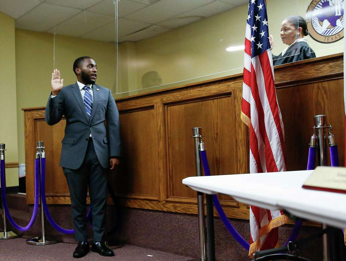 Prairie View City Councilman Nathan Alexander III is sworn by Judge Shelytha Alexander-Simmons on Monday, Nov. 16, 2020. Alexander, one of the youngest Black elected officials in the state of Texas, graduated from Prairie View A&M in 2020.