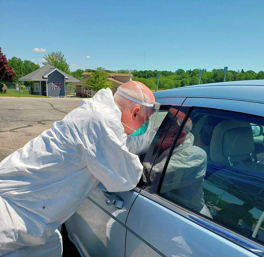 A member of the National Guard could be seen collecting a sample during the Manistee COVID-19 screening from June 25-26 at Manistee High School's parking lot. (File photo)