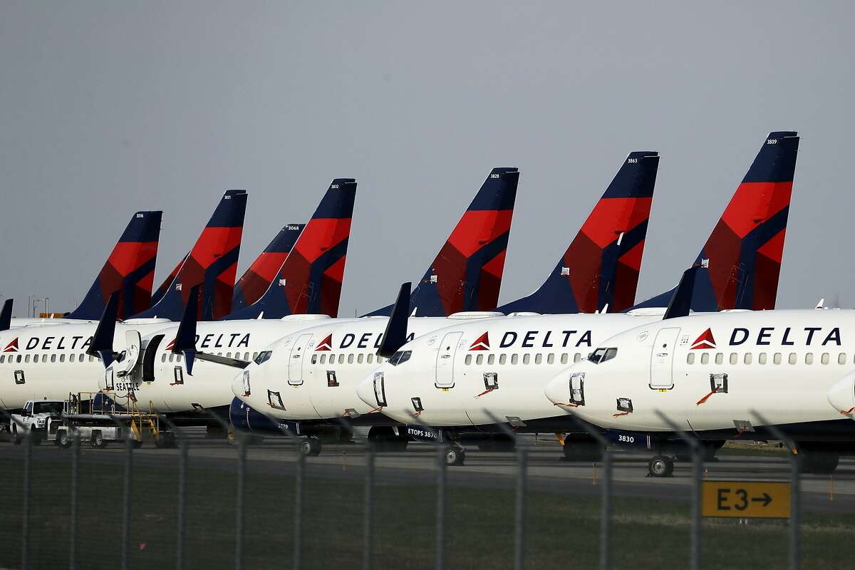 FILE - In this April 1, 2020, file photo, several dozen Delta Air Lines jets are parked at Kansas City International Airport in Kansas City, Mo.