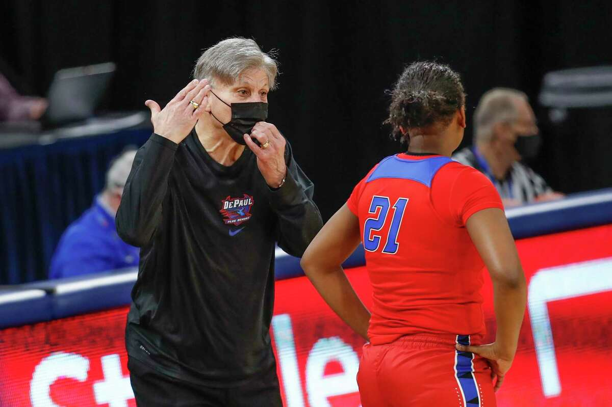Coach Doug Bruno, guard Darrione Rogers (21) and the DePaul women's baketball team face UConn on Tuesday.