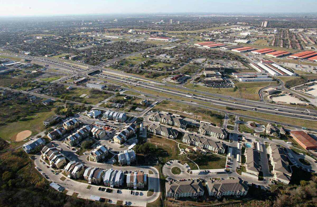 Traffic moves along Interstate 35 between the Sutton Oaks Apartment Community, foreground, and Joint Base San Antonio-Fort Sam Houston. Air Force officials are working with local police to investigate skeletal remains found in the northeastern portion of the post.