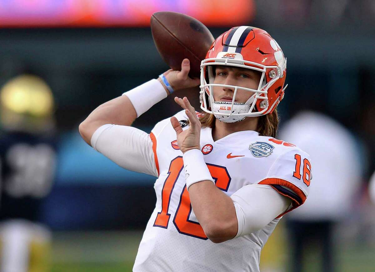 Clemson quarterback Trevor Lawrence warms up before the Atlantic Coast Conference championship NCAA college football game against Notre Dame, Saturday, Dec. 19, 2020, in Charlotte, N.C. (Jeff Siner/The News & Observer via AP)