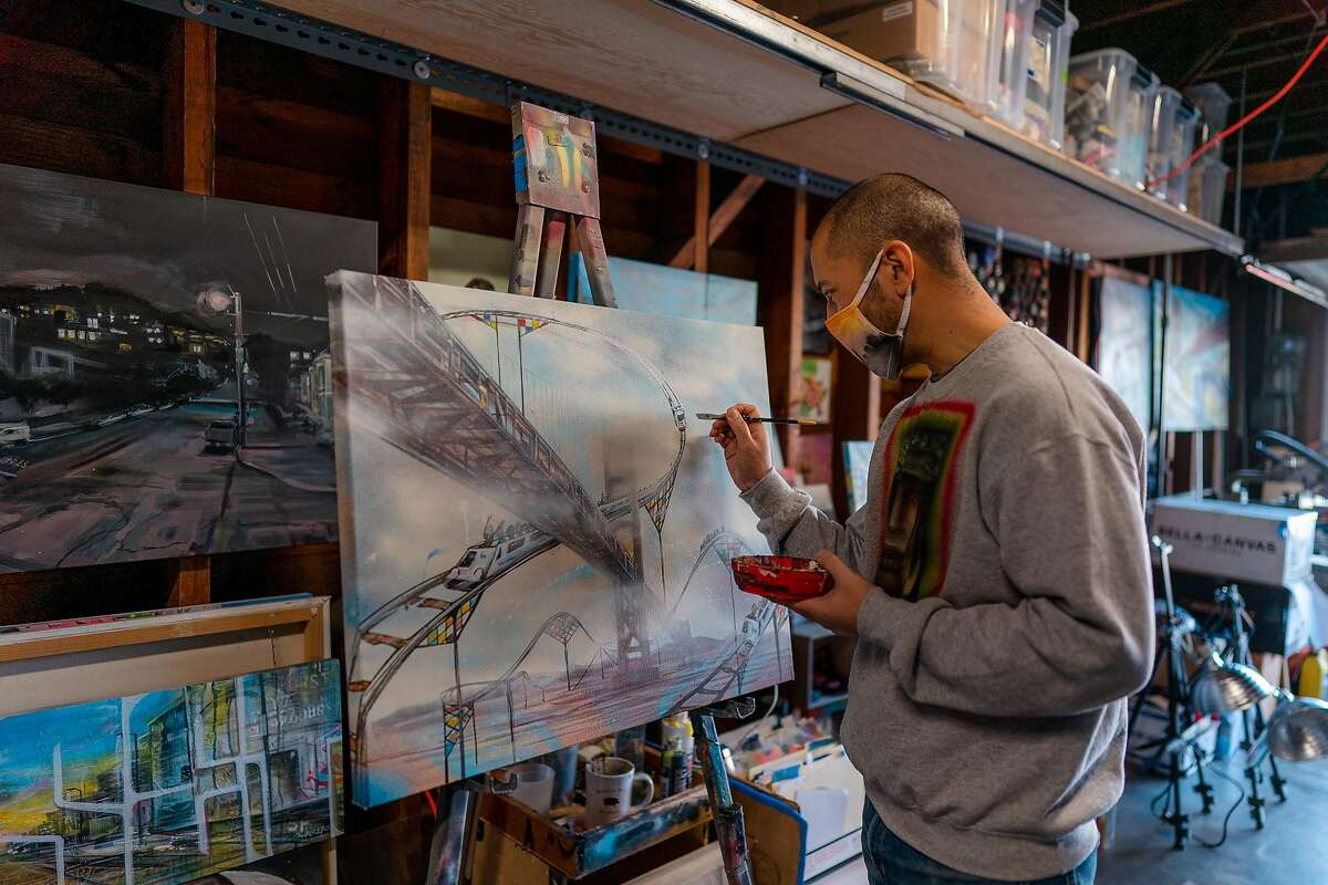Nathan Tan works on one of his Roller Coaster paintings at his garage studio in San Francisco, Calif., on Tuesday, December 22, 2020.
