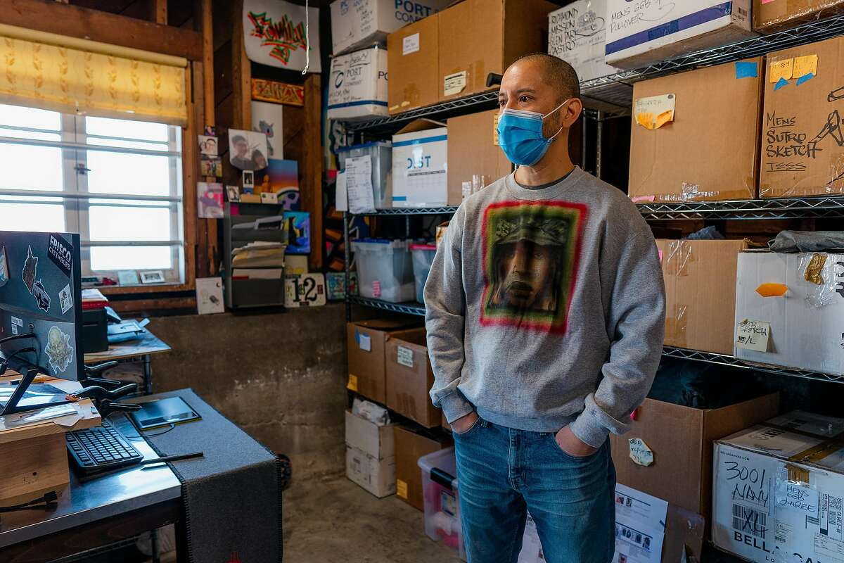 Nathan Tan stands in his garage studio where he paints, designs, runs his clothing business, and films a video series teaching kids how to draw in San Francisco, Calif., on Tuesday, December 22, 2020.