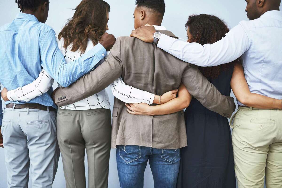 Pictured is a bereavement, and an interlocking of arms. The New Canaan-based Voices Center for Resilience (VoicesCenter.org) is hosting its
