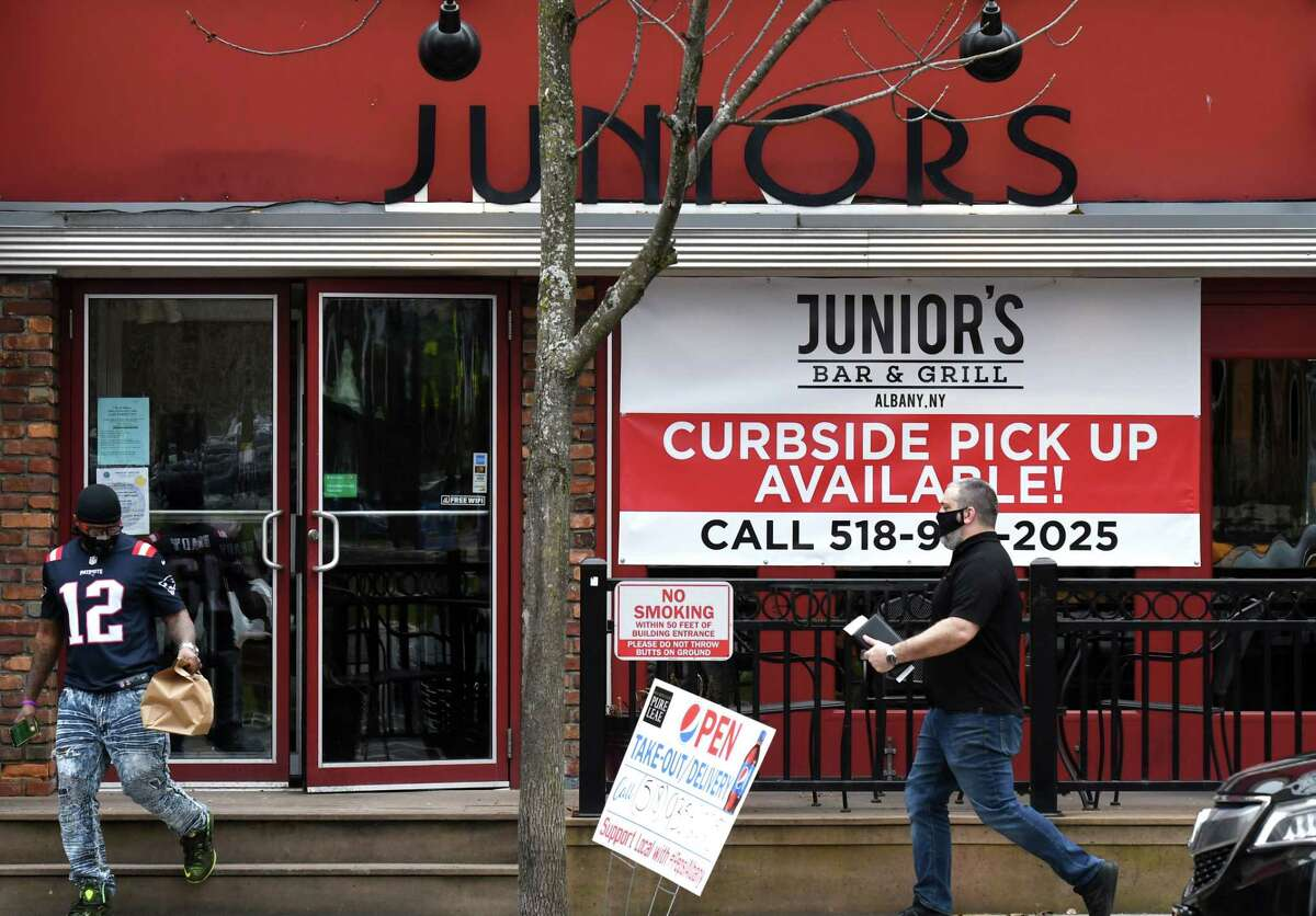 Food is picked up from Junior's Bar & Grill on Wednesday, April 29, 2020, on Madison Avenue in Albany, N.Y. Some restaurants have switched to takeout service only during the coronavirus lockdown, while others closed.