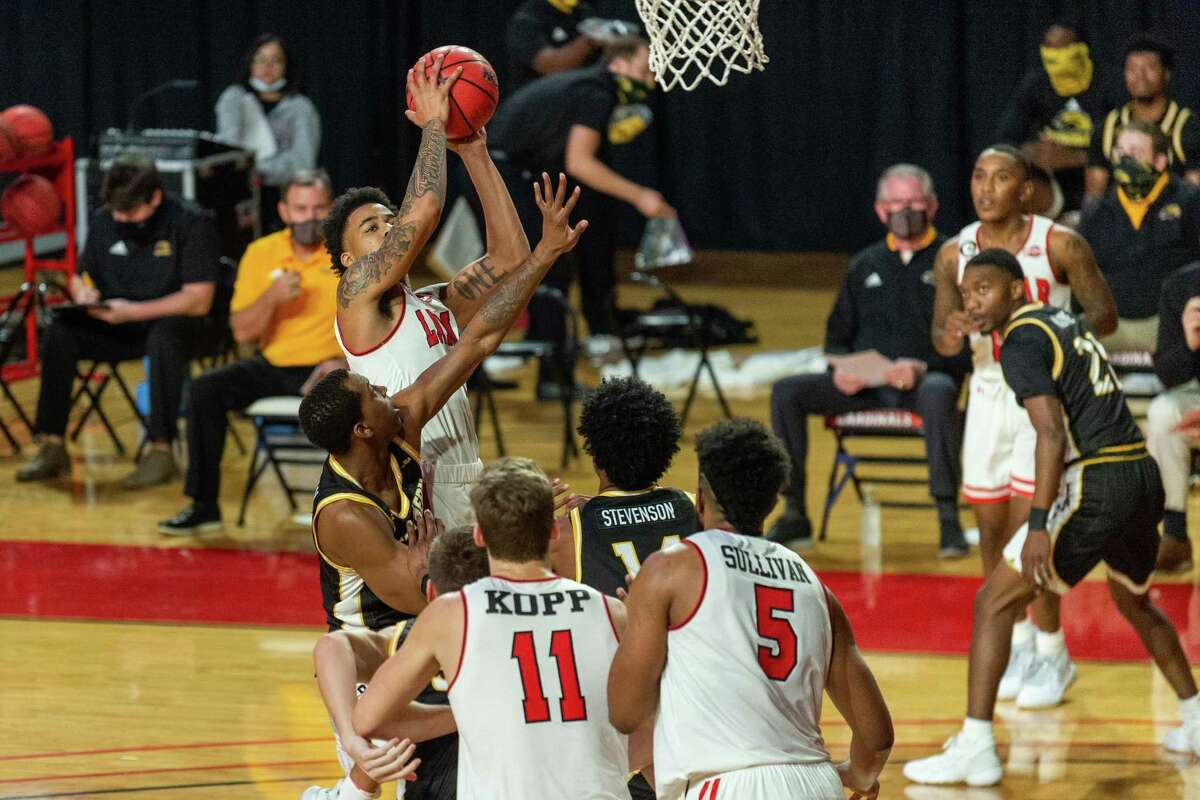 Cardinals Kasen Harrison (4) puts up a shot in traffic in the first half. The Lamar Cardinals men's basketball team hosted the Southern Mississippi Golden Eagles at the Montagne Center Tuesday night. Photo made on December 15, 2020. Fran Ruchalski/The Enterprise