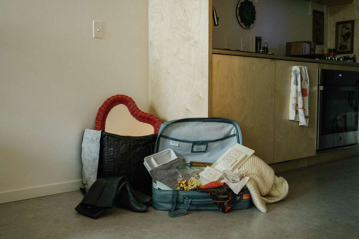 A pile of items waiting to be donated at Liz Chai's home in Portland, Ore., Dec. 19, 2020. Chai has donated a large majority of her belongings to live a more minimalist lifestyle. (Nils Ericson/The New York Times)