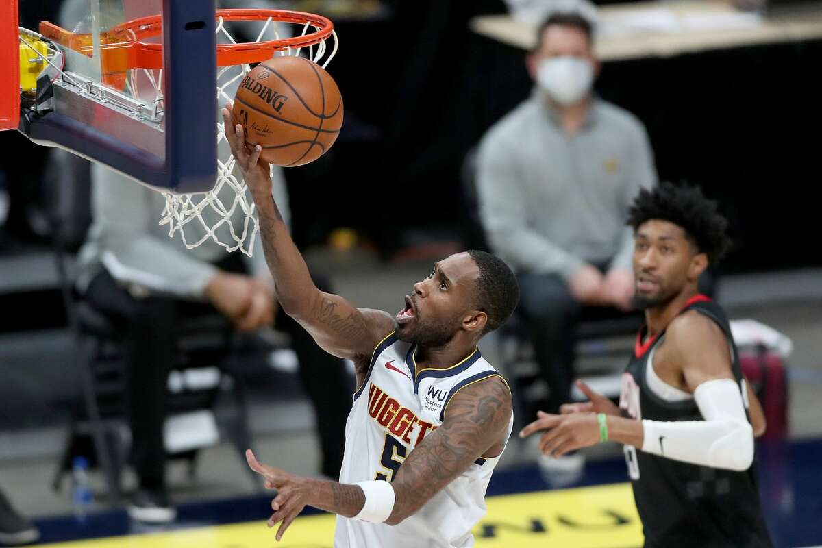DENVER, COLORADO - DECEMBER 28: Will Barton #5 of the Denver Nuggets takes the ball to the basket against the Houston Rockets in the second quarter at Ball Arena on December 28, 2020 in Denver, Colorado. NOTE TO USER: User expressly acknowledges and agrees that, by downloading and or using this photograph, User is consenting to the terms and conditions of the Getty Images License Agreement. (Photo by Matthew Stockman/Getty Images)